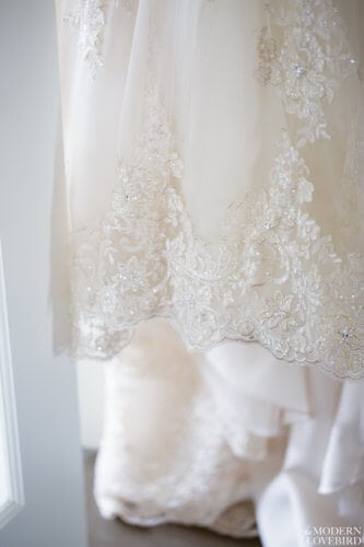 Wedding dress lace hem. Photo credit: The Modern Lovebird